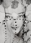 Woman, peeking through veil, 1938 by Erwin Blumenfeld